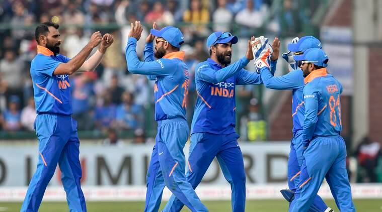 Indian cricket team captain Virat Kohli celebrates with teammates the dismissal of Australian batsman Peter Handscomb during the 5th ODI cricket match, at Feroz Shah Kotla Cricket Stadium in New Delhi