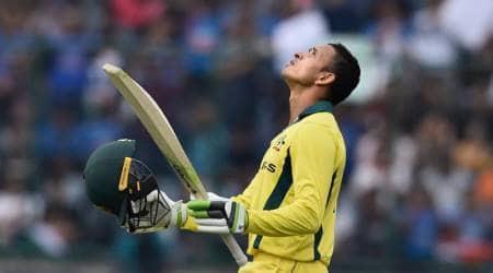Australian batsman Usman Khawaja raises his bat after scoring his century during the 5th ODI cricket match against India, at Feroz Shah Kotla Cricket Stadium in New Delhi