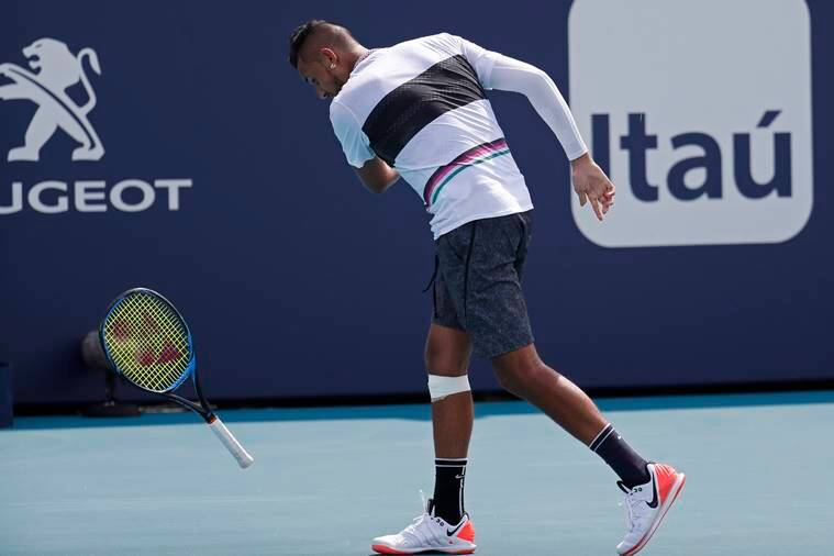 Nick Kyrgios of Australia smashes his racquet after missing a shot against Borna Coric of Croatia (not pictured) in the fourth round of the Miami Open at Miami Open Tennis Complex.
