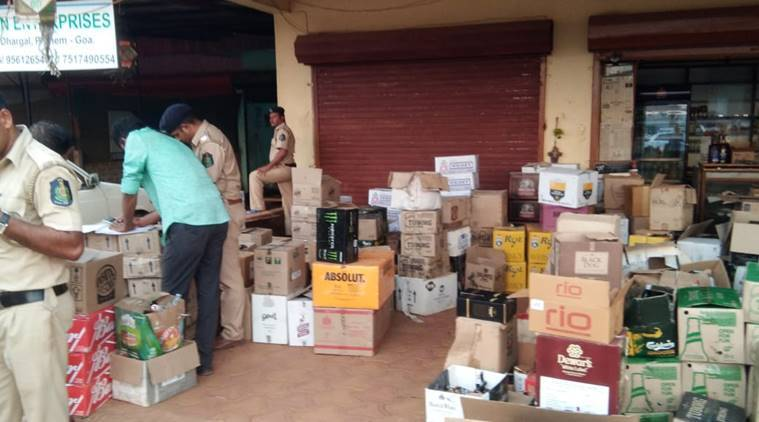Goa Police with the seized liquor (Express Photo)