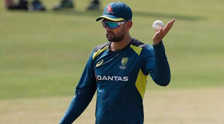 Australia's Nathan Lyon prepares to bowl in the nets during a training session on the eve of their second T20 international cricket match against India in Bangalore, India