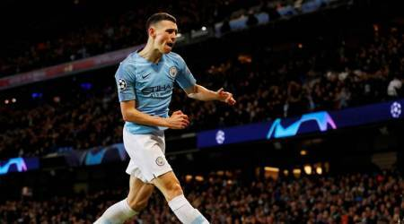 Manchester City's Phil Foden celebrates scoring their sixth goal against Schalke