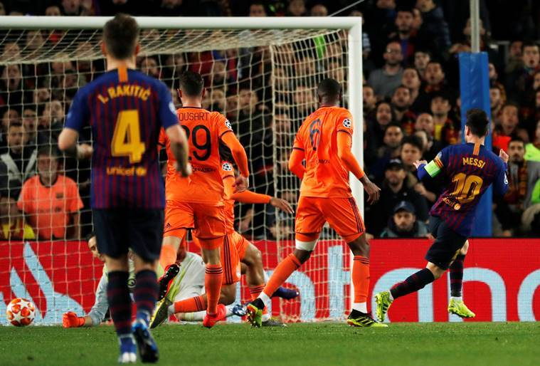 Barcelona's Lionel Messi scores their third goal