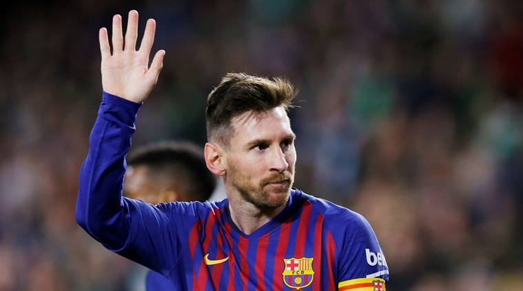 Barcelona's Lionel Messi celebrates scoring their fourth goal to complete his hat-trick