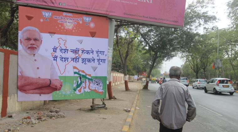 "Various hoardings with messages such as ""Modi hai toh mumkin hai"" (If Modi is there, it is possible) were set up across Ahmedabad. (Express photo/Javed Raja)"