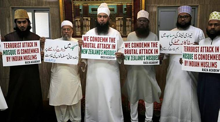 Indian Muslims hold placards during a condolence meeting and protest against Friday's mass shootings in New Zealand in Mumbai. (AP)