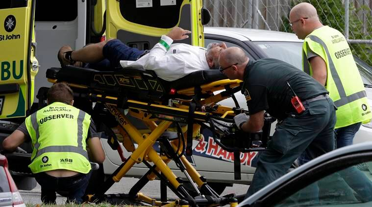 Ambulance staff take a man from outside a mosque in central Christchurch, New Zealand