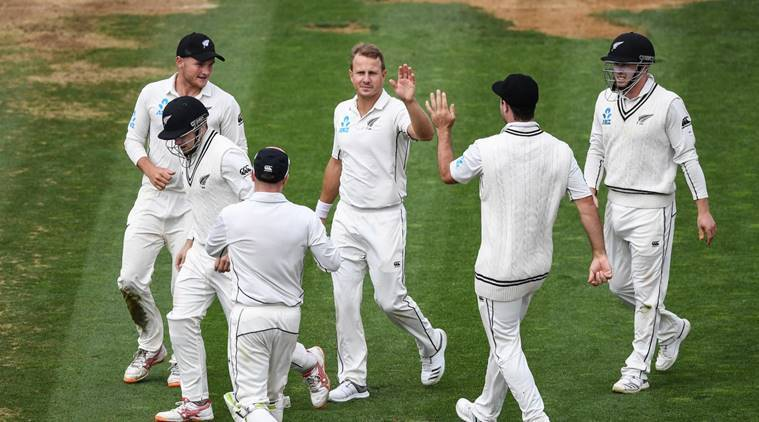 New Zealand players celebrate fall of wicket against Bangladesh in second Test
