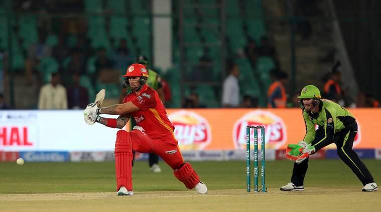 Islamabad United batsman Cameron Delport, left, plays a shot while Lahore Qalandar's wicketkeeper Riki Wessels look on during their Pakistan Super League cricket match at National Stadium in Karachi, Pakistan