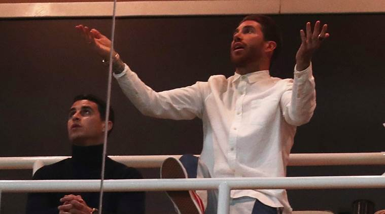 Real Madrid's Sergio Ramos gestures from the stands during the match REUTERS