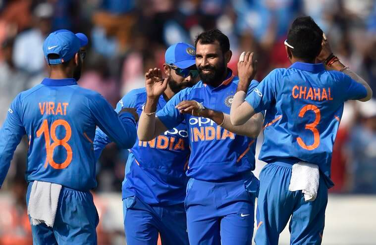 Mohammed Shami celebrates with teammate the dismissal of Australia's Glenn Maxwell on the first One Day International (ODI) series cricket match, at Rajiv Gandhi International Cricket Stadium in Hyderabad