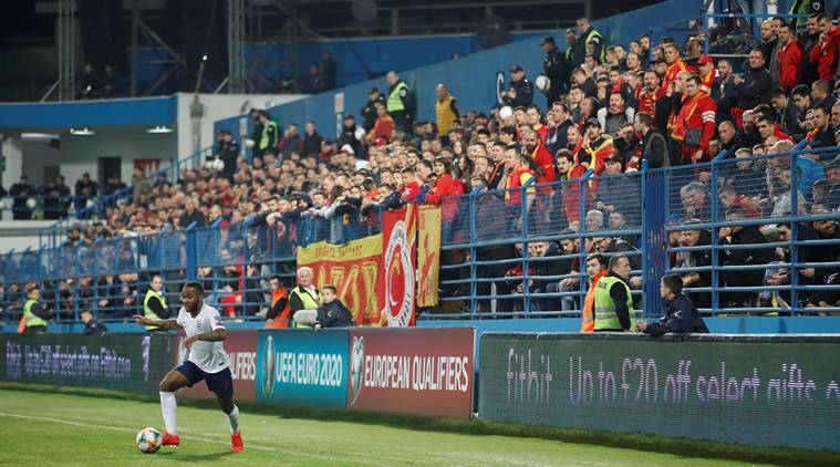 England's Raheem Sterling and Montenegro fans during the match