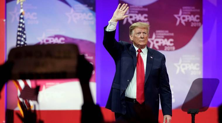 US President Donald Trump waves after speaking at the Conservative Political Action Conference annual meeting