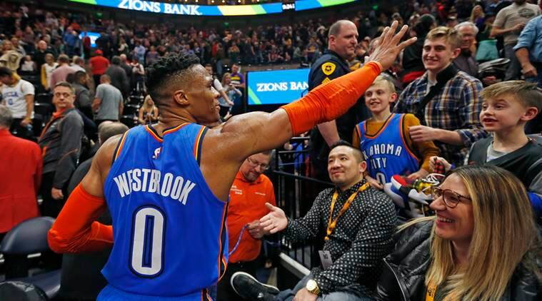 Russell Westbrook waves to the crowd as he leaves the court following an NBA basketball game against the Utah Jazz