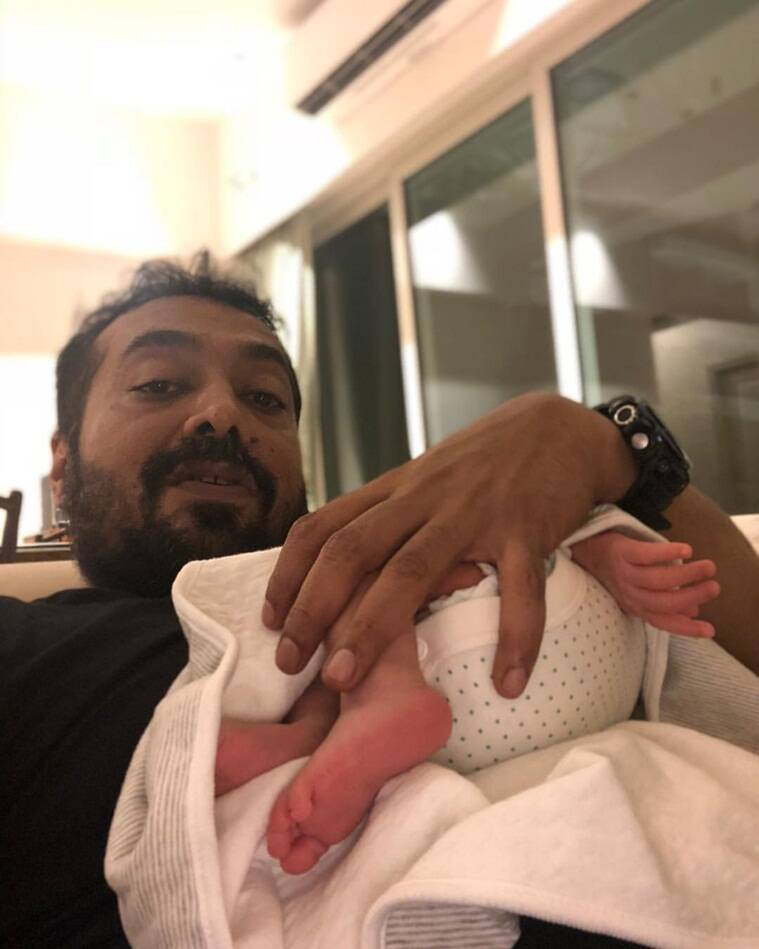 Anurag Kashyap posted a photo holding Surveen Chawla';s daughter