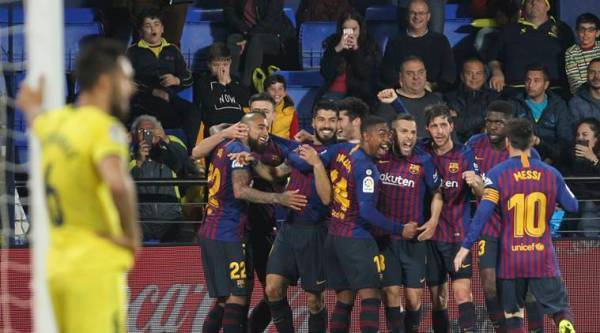 Barcelona forward Luis Suarez celebrates with teammates after scoring his side's fourth goal during the Spanish La Liga soccer match between Villarreal and FC Barcelona at the Ceramica stadium in Villarreal, Spain
