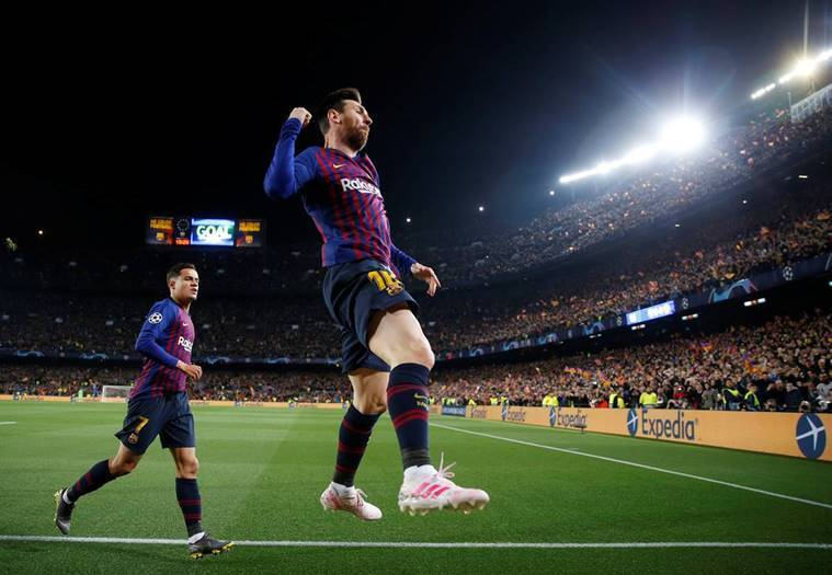 Barcelona's Lionel Messi celebrates scoring their first goal against Manchester United