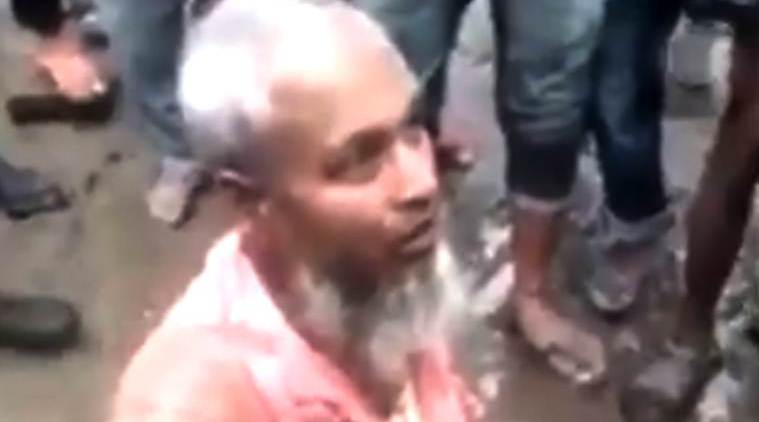 assam man thrashed, assam muslim man thrashed, assam muslim man forced to eat pork, assam cow slaughter, sarbananda sonowal, assam news