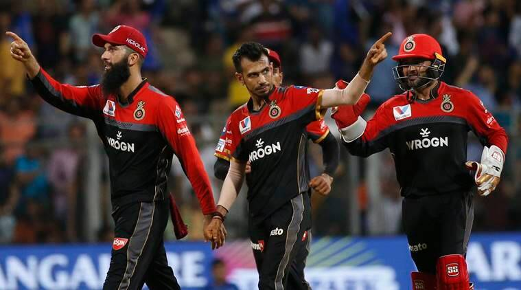 Royal Challengers Bangalore's Yuzvendra Chahal , center, with his team players celebrates dismissal of Mumbai Indians Suryakumar Yadav during the VIVO IPL T20 cricket match between Mumbai Indians and Royal Challengers Bangalore in Mumbai