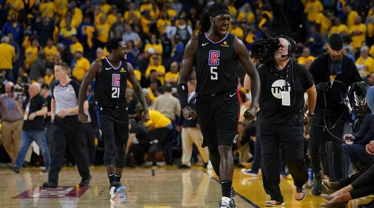 LA Clippers forward Montrezl Harrell (5) and guard Patrick Beverley (21) celebrate after game two of the first round of the 2019 NBA Playoffs against the Golden State Warriors at Oracle Arena.