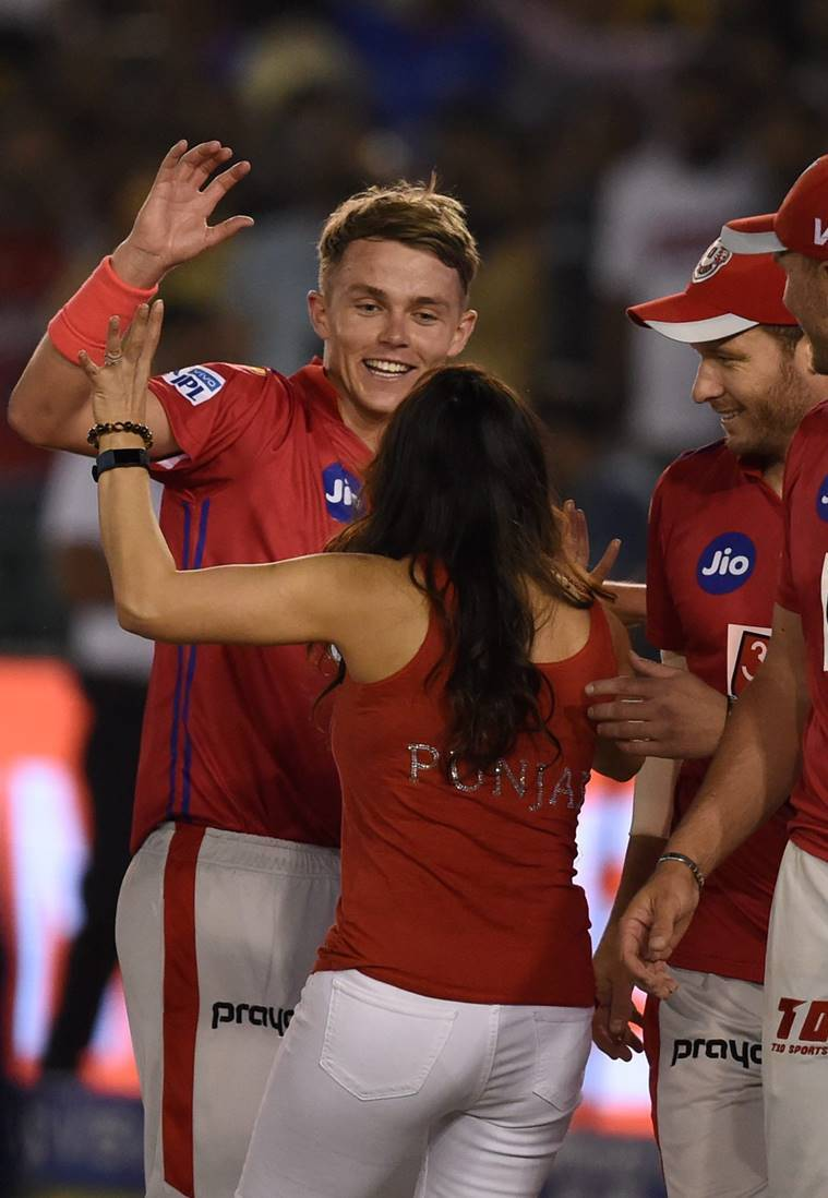 KXIP co-owner Preity Zinta with bowler Sam Curran as they celebrates after winning the Indian Premier League 2019 (IPL T20) cricket match against Delhi Capitals (DC) at I.S Bindra Stadium in Mohali