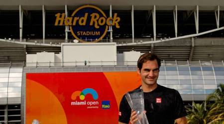 Roger Federer of Switzerland poses with the trophy after defeating John Isner of the United States (not pictured) during the men's finals at the Miami Open at Miami Open Tennis Complex.