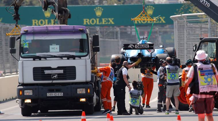 George Russell's Williams F1 car is recovered after stopping on track.