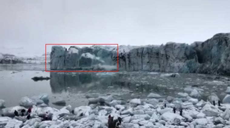 Glacier calves into lagoon forcing tourists to flee giant waves