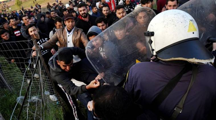 Greek police fire tear gas at migrants as border convoy grows