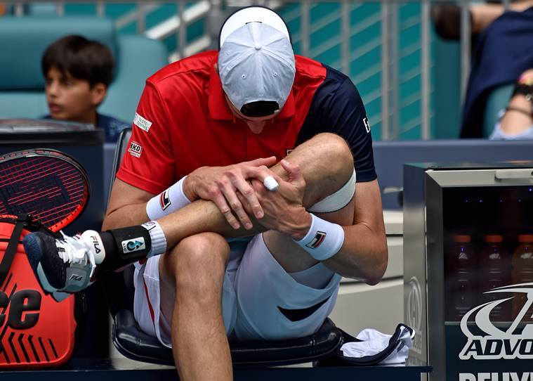 John Isner of the United States reacts after suffering an apparent injury in a match against Roger Federer of Switzerland (not pictured) during the men's finals at Miami Open Tennis Complex.