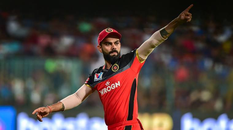 RCB Skipper Virat Kohli gestures at his team members during the Indian Premier League 2019 (IPL T20) cricket match between Royal Challengers Bangalore (RCB) and Mumbai Indians (MI), at Chinnaswamy Stadium in Bengaluru