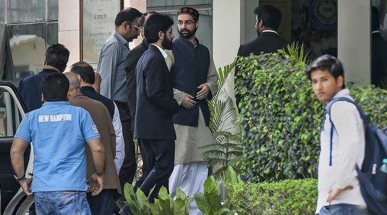 Mirwaiz Umar Farooq arrives at National Investigation Agency (NIA) in connection with a case related to terror funding, in New Delhi, Monday. (PTI)