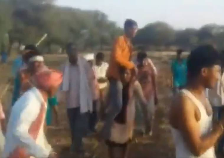 MP woman video, woman carrying husband on shoulder video, Jhabua district, woman carrying husband video, mp women punishment, Jhabua woman video, video india news, indian express