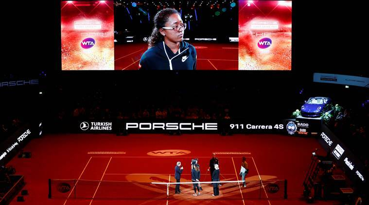 Japan's Naomi Osaka is interviewed on the court after she withdrew from her semi final match against Estonia's Anett Kontaveit due to injury