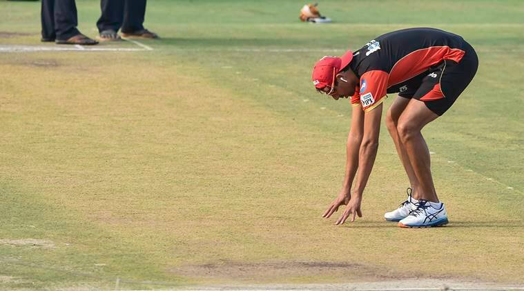 RCB bowling coach Ashish Nehra inspects the pitch during a training session ahead of the Indian Premier League 2019 (IPL T20) cricket match between Sunrisers Hyderabad (SRH) and Royal Challengers Bangalore (RCB), at Rajiv Gandhi International Cricket Stadium, in Hyderabad