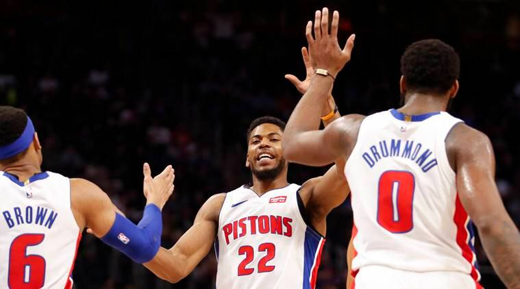 Detroit Pistons guard Glenn Robinson III (22) celebrates with center Andre Drummond (0) and guard Bruce Brown (6) during the third quarter against the Memphis Grizzlies at Little Caesars Arena.