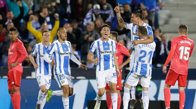 Leganes players celebrate after scoring against Madrid during a Spanish La Liga soccer match in Leganes, outskirts Madrid, Spain