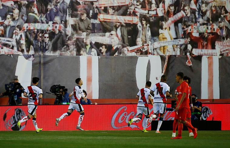 Rayo Vallecano players celebrate scoring against Real Madrid