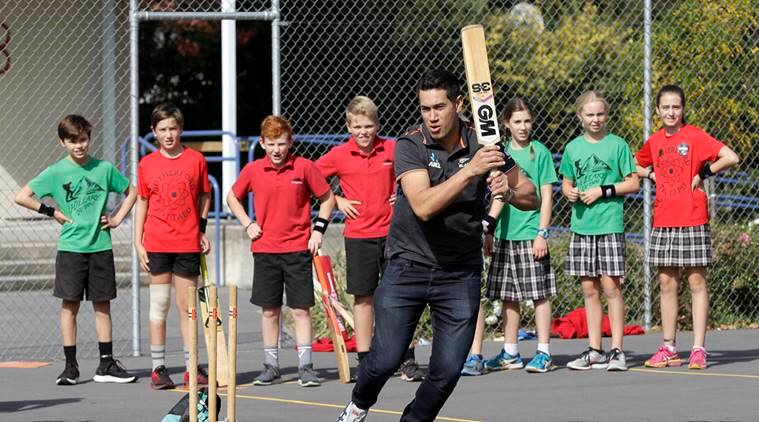 New Zealand cricketer Ross Taylor bats as he plays cricket with children at Tai Tapu School outside Christchurch, New Zealand
