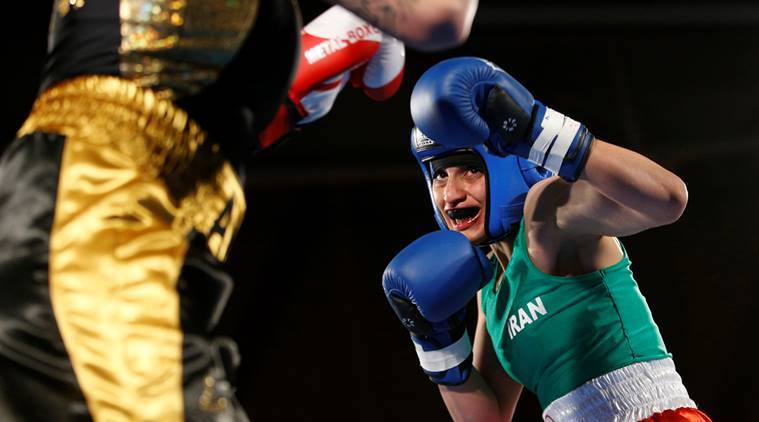 Iranian boxer Sadaf Khadem in action against French boxer Anne Chauvin during an official boxing bout in Royan, France.