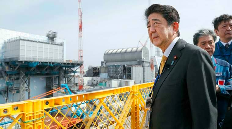 Shinzo Abe declares victory in Japan election but without mandate to revise Constitution