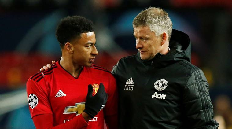 Manchester United manager Ole Gunnar Solskjaer and Manchester United's Jesse Lingard react after the match against Juventus