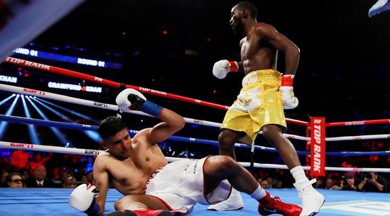 Terence Crawford Wins By Technical Knockout When Amir Khan Doesn't Go On After Low Blow
