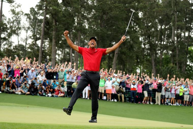 Tiger Woods of the U.S. celebrates on the 18th hole after winning the 2019 Masters.