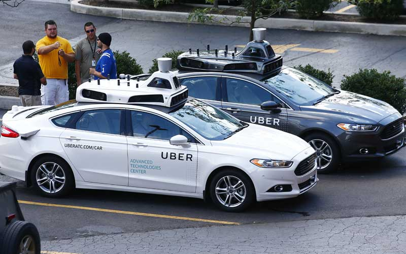 Uber's autonomous vehicle unit has raised  billion from a consortium of investors including SoftBank Group Corp, giving the company a much-needed funding boost for its pricey self-driving ambitions
