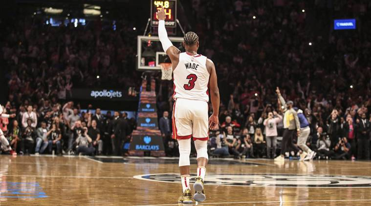 de4711679fc3 Miami Heat guard Dwyane Wade (3) signals to the crowd after scoring in the