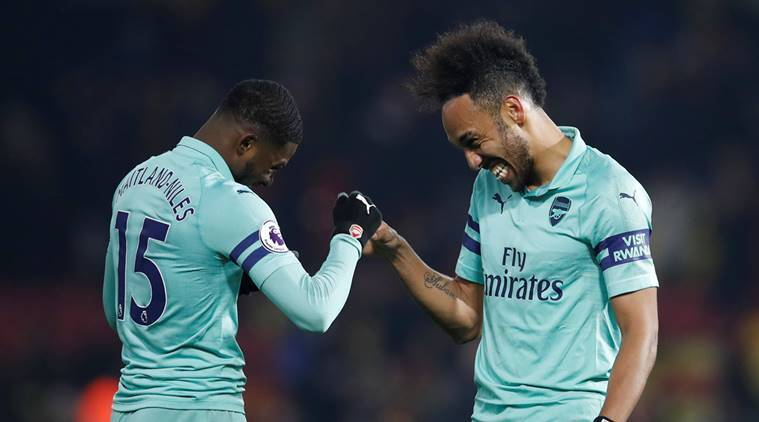 Arsenal's Pierre-Emerick Aubameyang and Ainsley Maitland-Niles celebrate after the match against Watford