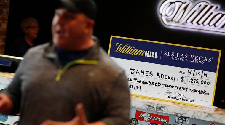 James Adducci speaks with the media in front of a novelty check after winning more than one million dollars betting on Tiger Woods winning the Masters.