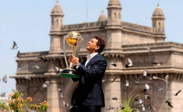 India's Sachin Tendulkar lifts the trophy at the Taj hotel, the day after India defeated Sri Lanka by six wickets in the ICC Cricket World Cup final, in Mumbai