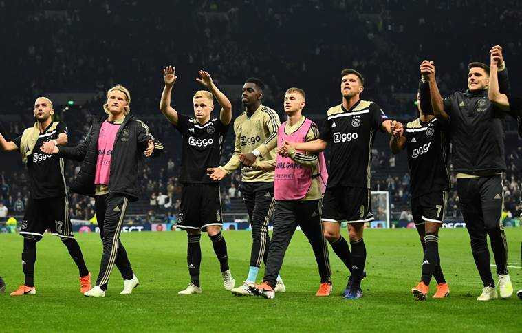 Ajax players celebrate after the match vs Spurs